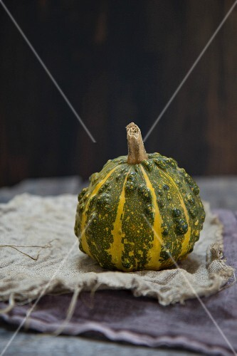 A green and yellow squash