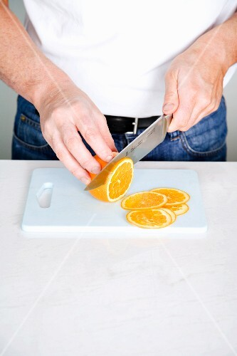 An orange being finely sliced