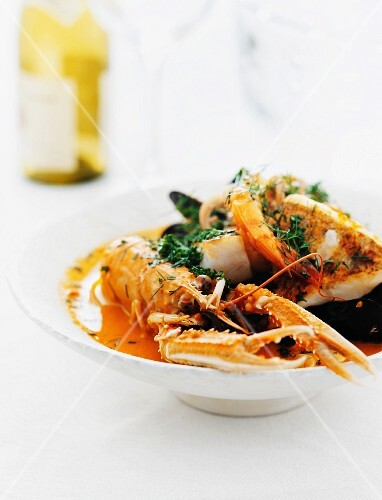 A fish platter with lobster, cod and mussels