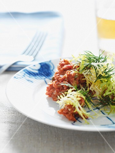 Beef tatar with frisee lettuce