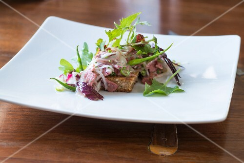Veal head with a mixed leaf salad