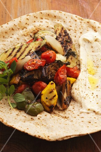 Grilled vegetables and hummus on pita bread