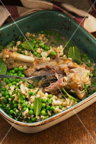 Leg of lamb with barley, peas and mint