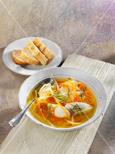 Fish soup with vegetables strips and hake dumplings