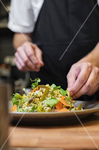 Potato salad being arranged on a plate
