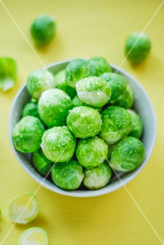 A bowl of freshly washed Brussels sprouts