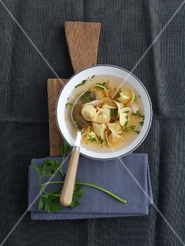Clear broth with cappelletti and parsley