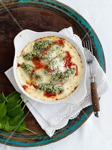 Malfatti (Italian spinach dumplings) with cheese and tomato sauce