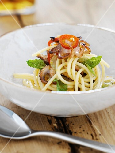 Spaghetti with fried mini octopus and tomatoes