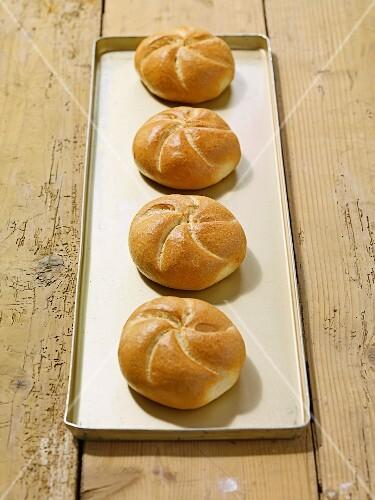Four fresh bread rolls