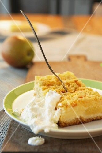 Apple crumble cake and whipped cream
