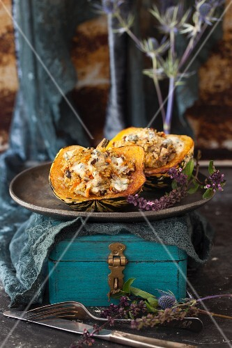Baked acorn squash filled with chestnuts, mushrooms and quinoa