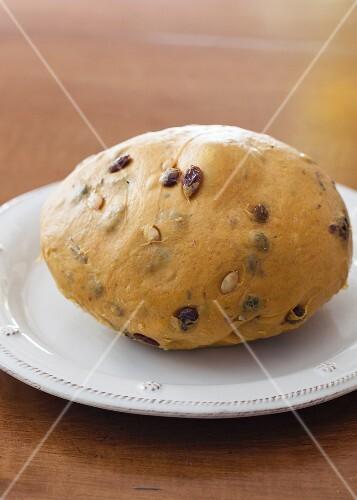 Dough for pumpkin bread with raisins, dried cherries and pumpkin seeds