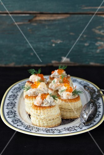 Vol-au-vents with a creamy mushroom sauce, shrimps, caviar and dill
