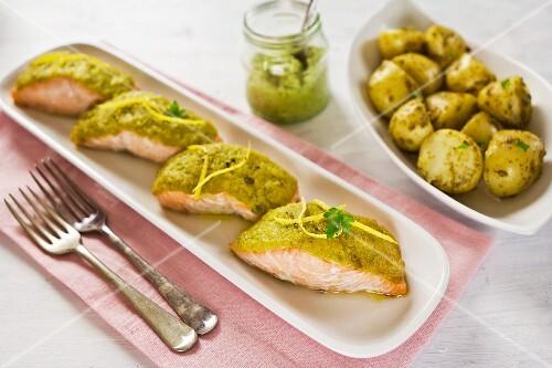 Oven-baked salmon with pesto potatoes