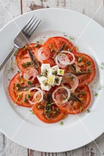 Tomato salad with anchovies, feta cheese, onions and capers