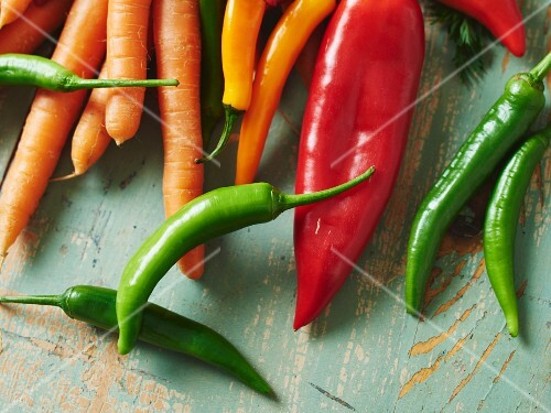 Carrots, pointed peppers and various chilli peppers