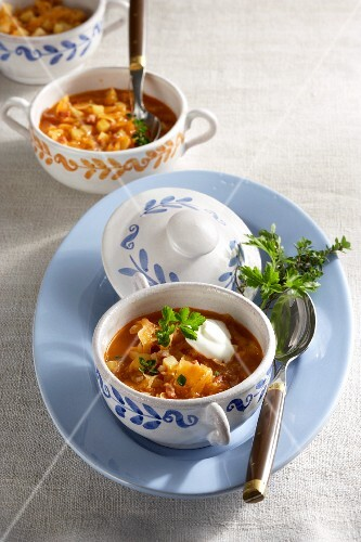 Sauerkraut soup with potatoes and sour cream