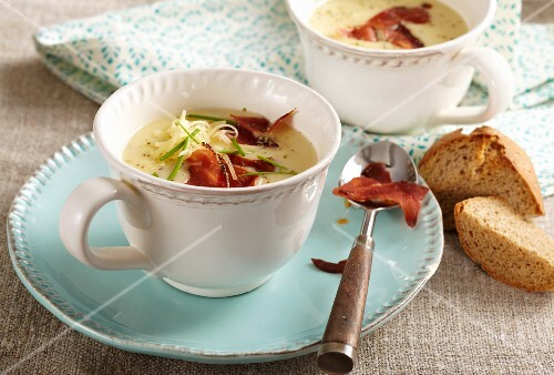 Potato and cheese soup with ham chips