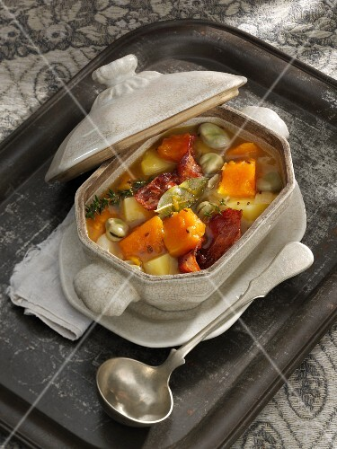 Pumpkin stew with broad beans, potatoes and bacon
