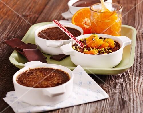 Chocolate crème brûlée with mandarins and pistachio nuts