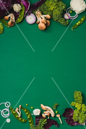 Various vegetables on a green surface