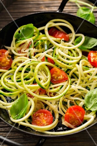 Courgette noodles with sautéed cherry tomatoes and basil