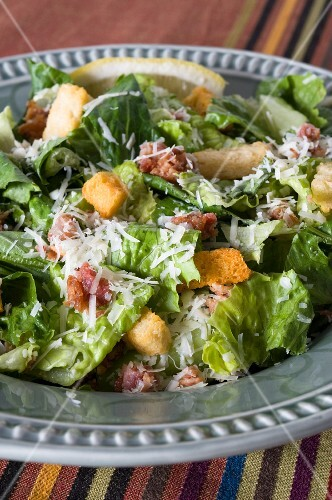 A large bowl of Caesar salad