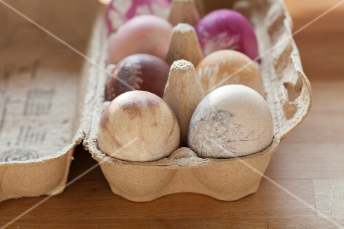 Easter eggs dyed using natural dyes in egg box