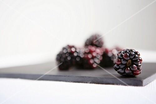 Blackberries on a grey board