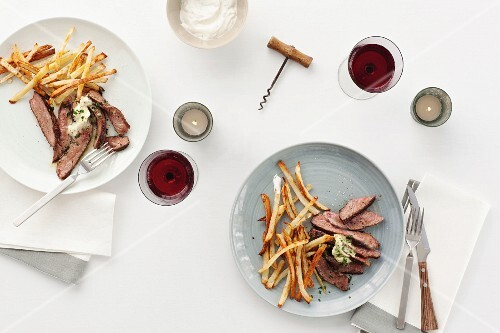 Beef steak with chips and red wine