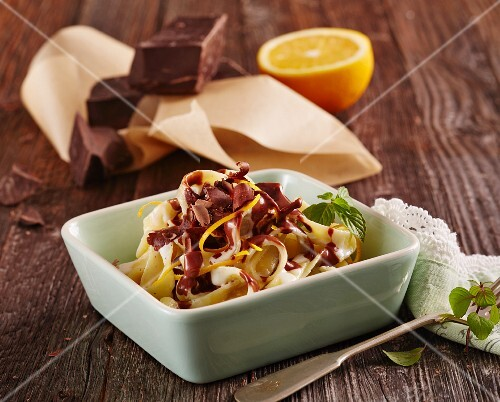 Sweet milk pasta with orange and chocolate sauce