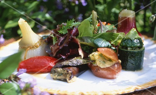 Various types of stuffed vegetables on a plate with lettuce
