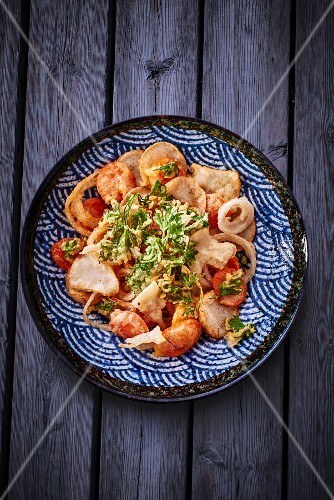 A plate of fried vegetables and herbs