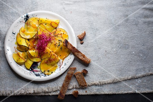 Winter radish carpaccio with grated red cabbage