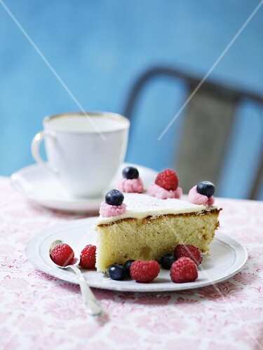 A slice of berry cake with icing
