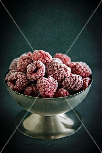 Frozen raspberries in an ice cream bowl
