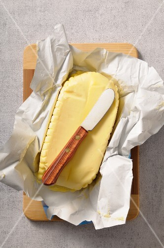 Butter on a piece of paper with a butter knife