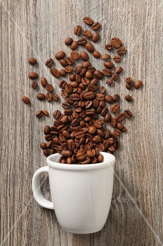 Coffee beans and a white cup