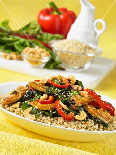 Hoisin chicken with cashew nuts, chard and pepper on a bed of millet