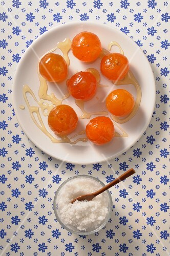 Candied clementines on a plate seen from above