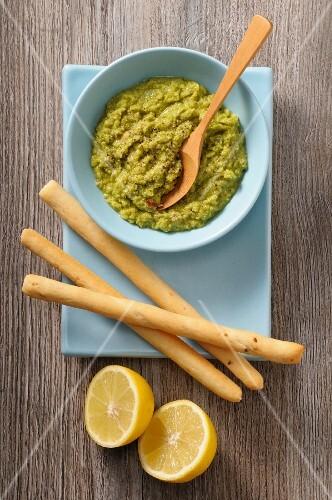 Guacamole, grissini and lemons