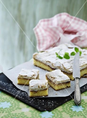 Tray bake cake with jam and meringue