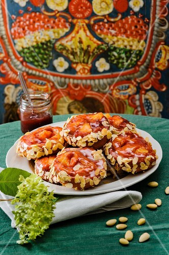 Apple fritters topped with jam and flaked almonds