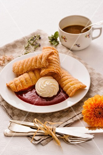 Spagatkrapfen (deep-fried crispy wafers from Austria) with damson mousse and whipped cream
