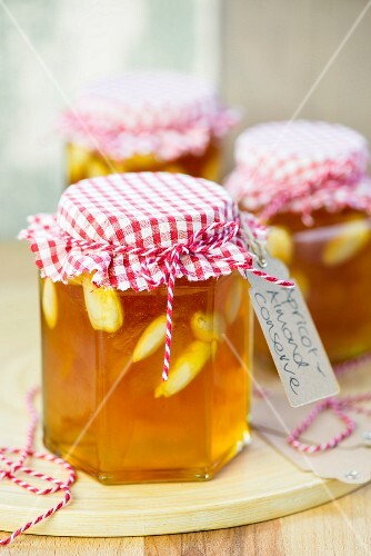 Jars of apricot jam with whole almonds
