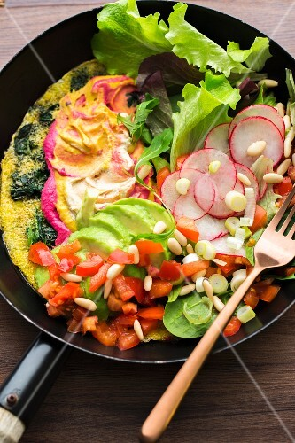 Garlic and spinach omelette with hummus and vegetables