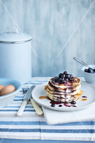 A stack of pancakes with blueberries