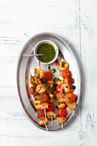 Prawn skewers with cherry tomatoes, bread and a basil sauce