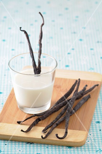 A glass of milk with vanilla pods